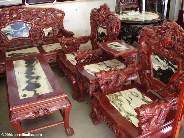Wood and marble furniture for sale at a shop in Dali  Yunnan  China. and marble furniture for sale at a shop in Dali  Yunnan  China